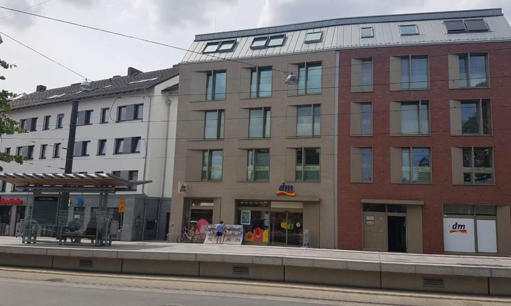 Fassade der Multi-Tenant- Immobilie hinter dem Bahnsteig - Hörtkorn Finanzen Heilbronn bietet lukrativen Club Deal